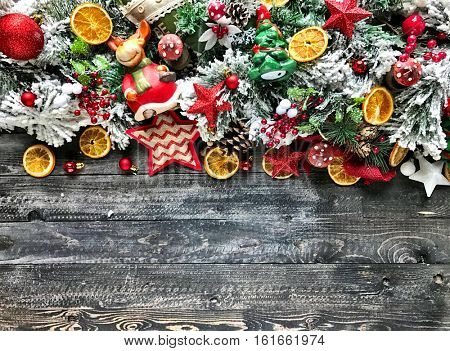 Holiday Christmas background with themed decirations like pines, trees, hearts, stars, oranges and baubles to use for your seasonal flyers