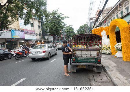BANGKOKTHAILAND - December 04:Unidentified man transports flower by Tuk Tuk car at Pak Khlong Talat market in BangkokThailand on December 04 2016