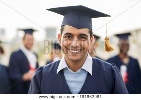 education, graduation, international and people concept - happy student in mortar board and bachelor gowns outdoors