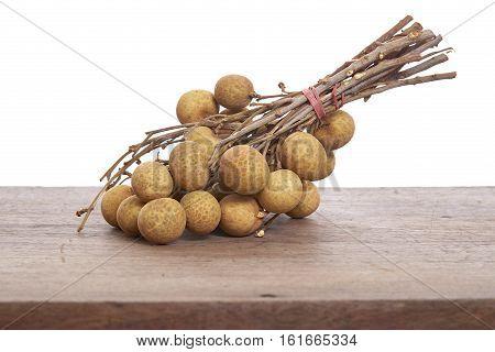 Fresh Longan on a wooden backgroundLocal Thai Fruits