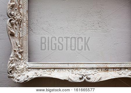 Vintage antique white frame on the white wall