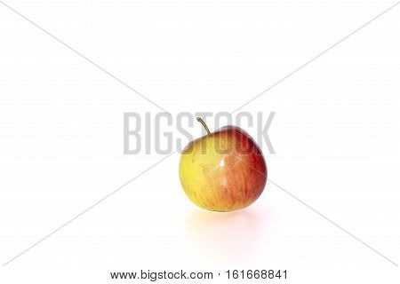 small juicy red and yellow apple against a white background with clipping path