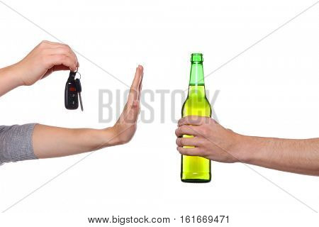 Woman with car key refusing bottle of beer, on white background. Don't drink and drive concept