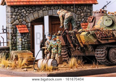 Soldiers load shells in german tank Panther and one going for fuel at european yard. World War 2 time. Miniature