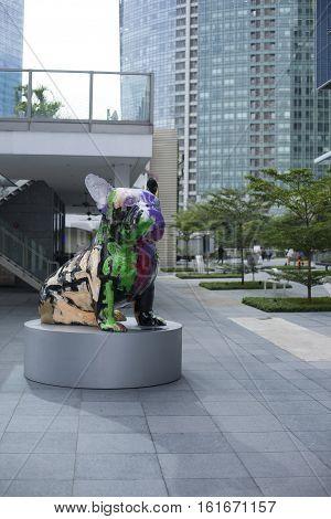Singapore - 01 November 2014: Modern art sculpture of artistic dog with graffiti on the street