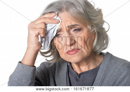 Portrait of senior woman feels sick isolated on white background