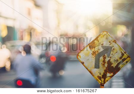 Traffic Sign,old Curve Road Sign On Blur Traffic Road Abstract Background.