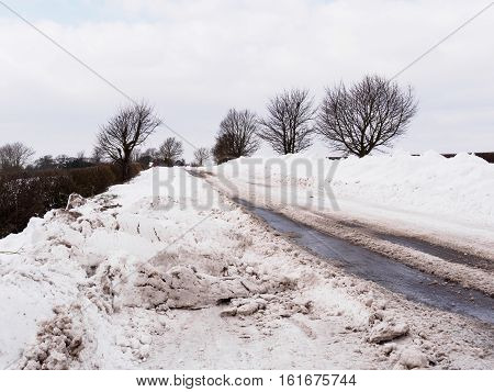 Snowdrifts by the side of the road between Melbourne and Hartshorne Derbyshire in late March 2013.