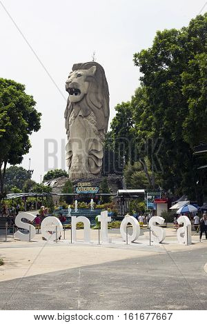 Singapore - 01 November 2014: Merlion Statue on theme park Sentosa. Day view, the head of a lion and the body of a fish