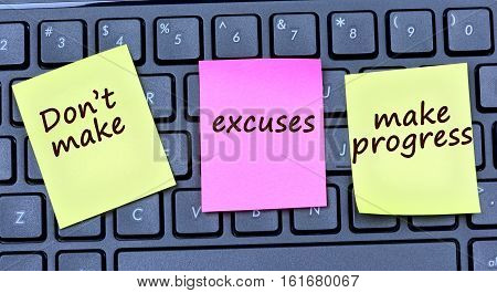 The words Don't make excuses make progress on colorful notes