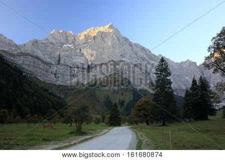 mountain with rock wall in the morning light