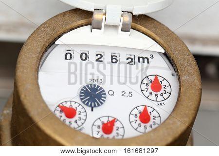macro shot of a water meter with measuring