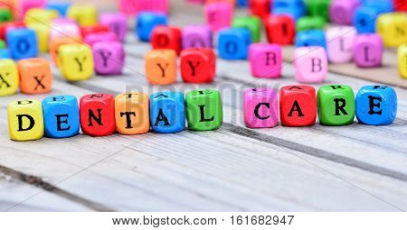 Dental care words on gray wooden table