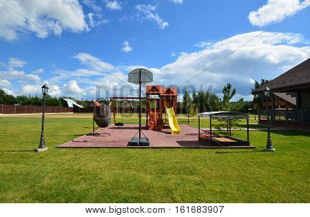 A children's Playground. Country house.Landscape. playground on the lawn in front of house