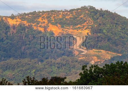 Erosion of hill indicating over development and destroy the enviroment poster
