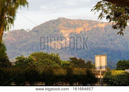 Erosion of hill indicating over development and destroy the enviroment