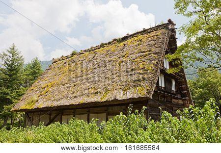 OGIMACI JAPAN - AUGUST 01 2016: Former Higahi Shina family residence (circa 19th c.) in Ogimachi gassho style village of Shirakawa-go district. World Heritage Site of UNESCO
