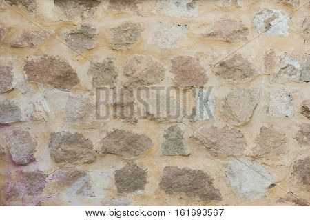 Texture background brick wall bright light outdoors