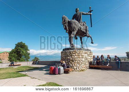 TELAVI, GEORGIA - SEP 30, 2016: Tourists relaxing near the monument of Georgian king of Kakheti Heraclius II Erekle II on 30 September, 2016. Telavi of Kakhetia has population 22000