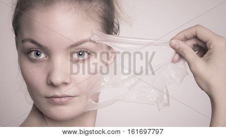 Girl Removing Facial Peel Off Mask