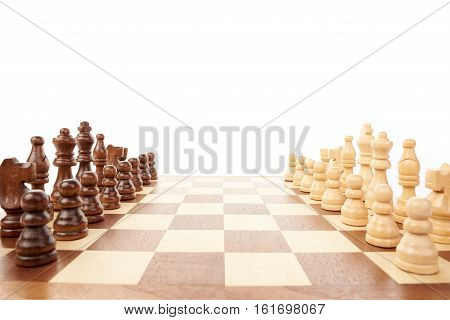 Wooden chess game with black an white chessmen on white background