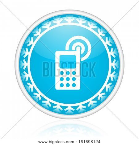 Mobile phone vector icon. Winter and snow design round web blue button. Christmas and holidays pushbutton.