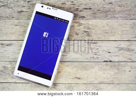 BUNG KAN THAILAND - SEPTEMBER 02 2015: smart phone on the table and facebook on screen