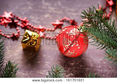 Christmas ball, gift box, bijouterie and fir tree branch