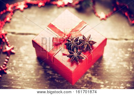 Red gift box and bijouterie on a wooden background