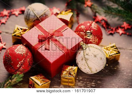Christmas balls, gift boxes, bijouterie and fir tree branch