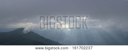 Landscape with fog mountain and sunset Doi Mon Jong Chiang Mai Thailand.