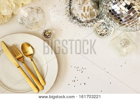 Overhead view of an elegant New Year's Eve table setting with room for copy.