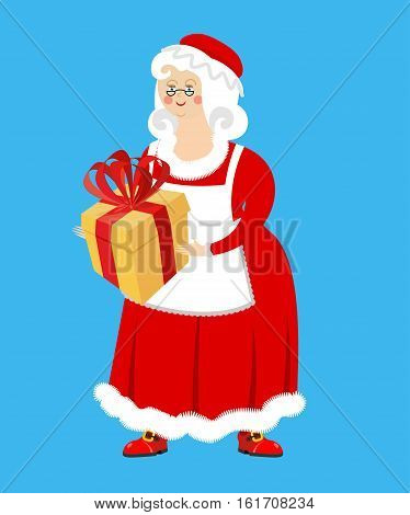 Mrs. Claus And Gift. Wife Of Santa Claus And Box. Christmas Woman In Red Dress And White Apron. Xmas
