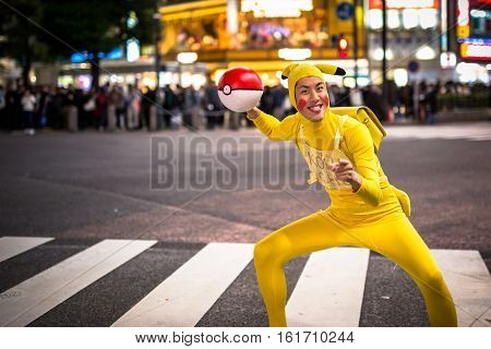 TOKYO, JAPAN - NOVEMBER 12, 2016: Man dressed up like Pikachu at Shibuya crosswalk in Tokyo, Japan. Pikachu is a central character in the Pokemon anime series, famous in Japan.