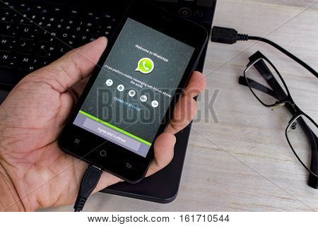 BUNG KAN THAILAND - APRIL 5 2016: Smart phone is charging battery and whatsapp app on screen