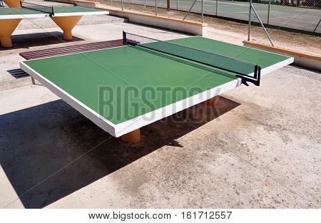 Green table tennis tables. Area for playing tennis