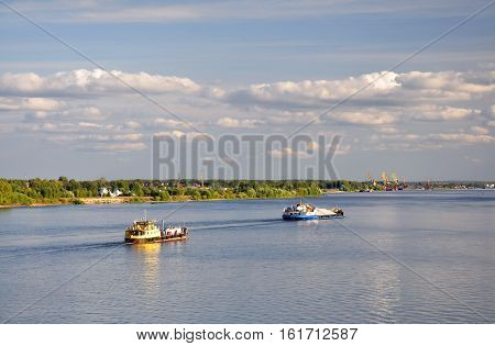 Two barges on the River. Navigation on the Volga.