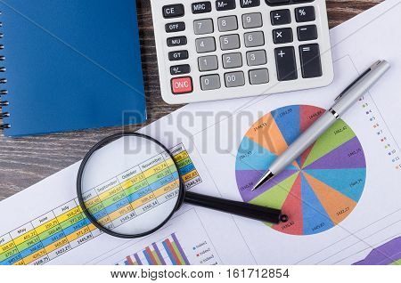Analysis Printouts With Table And Chart, Calculator And Pen
