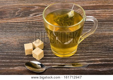 Pieces Of Brown Sugar, Cup Of Tea And Teaspoon