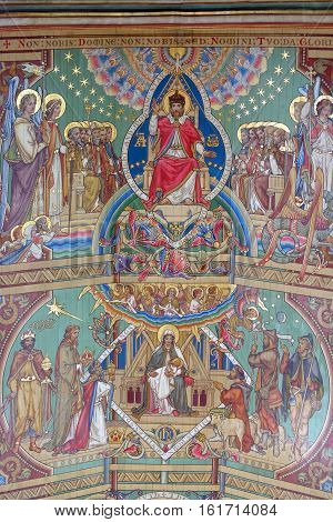 ELY, ENGLAND - JUNE 28, 2016: The last two panels of the nave ceiling of Ely Cathedral - a picture of Christ in heavenly glory and the Nativity story.