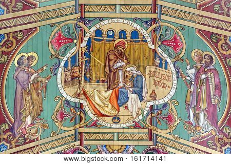 ELY, ENGLAND - JUNE 28, 2016: The tenth panel of the nave ceiling of Ely Cathedral - the nativity scene. The nave is the third longest in the UK and the same length as Ely High Street.