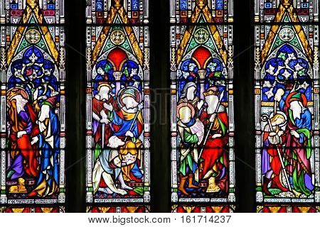 ELY, ENGLAND - JUNE 28, 2016: Interior Ely Cathedral - stained glass window. The only UK building recognized as one of the Seven Medieval Wonders of the world.