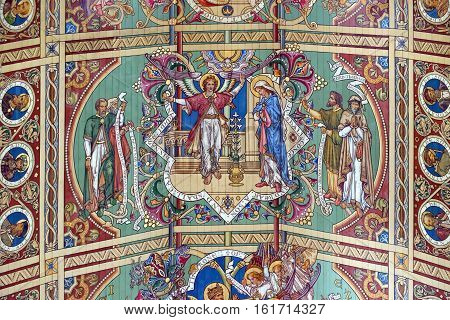 ELY, ENGLAND - JUNE 28, 2016: The nineth panel of the nave ceiling of Ely Cathedral - The Annunciation. The nave is the third longest in the UK and the same length as Ely High Street.
