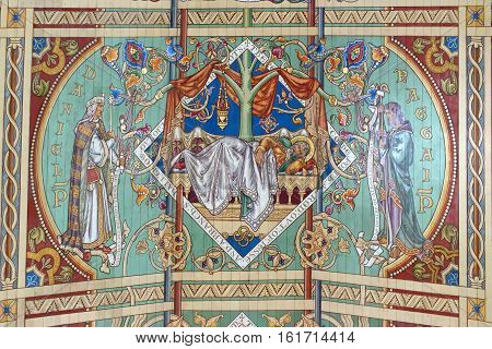 ELY, ENGLAND - JUNE 28, 2016: The seventh panel of the nave ceiling of Ely Cathedral - the Branch from Jesse. The nave is the third longest in the UK and the same length as Ely High Street.