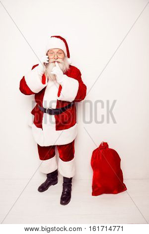Shh! Santa Claus With Christmas Bag Talking On Phone