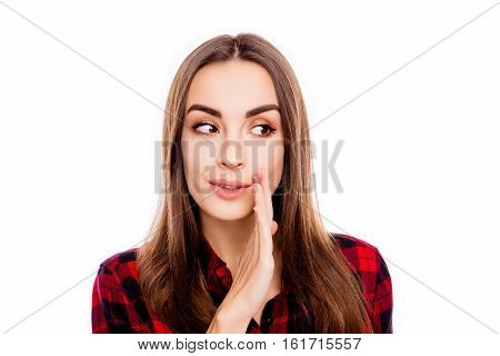 Pretty Young Girl Holding Hand Near Mouth And Telling Secret