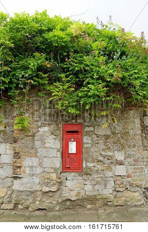 ELY, ENGLAND - JUNE 28, 2016: Post Box in Ely Cambridgeshire. Fine George sixth post box in the wall near the Cathedral of Ely.