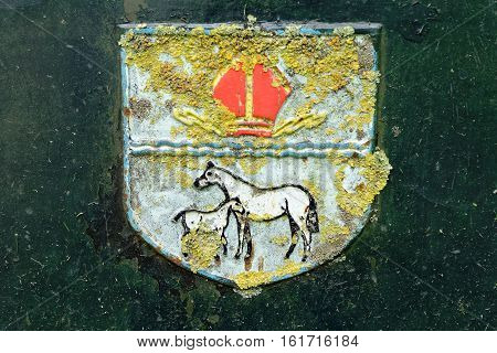 ELY, ENGLAND - JUNE 28, 2016: East Cambridgeshire coat of arms. The top of the shield is for Ely. The bottom part for the Newmarket Rural District.