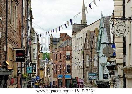 DURHAM, ENGLAND - JUNE 30 2016: Saddler Street known historically as Saddlergate joins the Market Place from the south and is the main route for tourists heading for the cathedral.