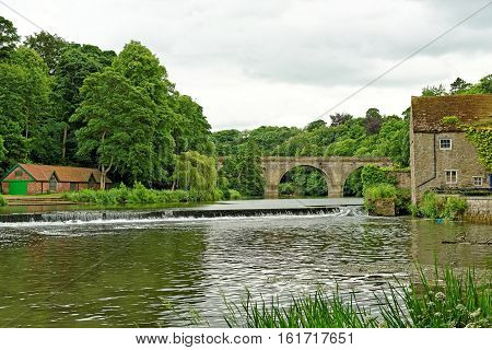 River Wear and Prebends Bridge a stone structure that spans the river in Durham North East England.
